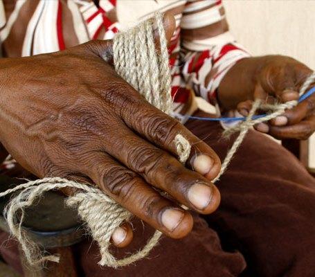 "Cathy Kata ""looping"", traditional hand-weaving technique used to make bilums  (Dan Lepsoe)"